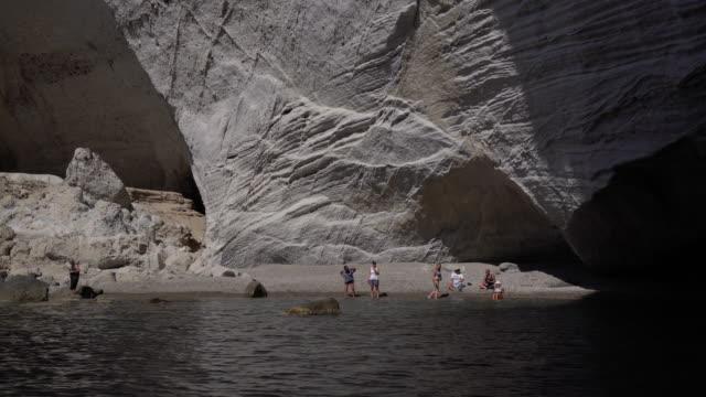 people enjoy beach in secluded cove - 40 49 lat filmów i materiałów b-roll