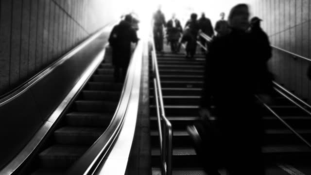 People entering a subway station - steps & escalator video