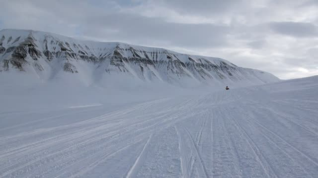 People expedition on snowmobile in North Pole Spitsbergen Svalbard Arctic. video