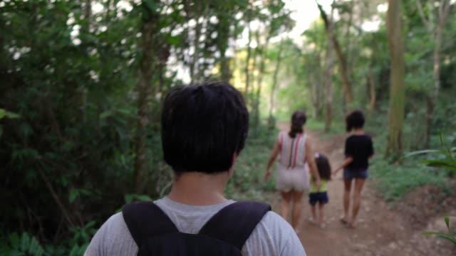 people exploring the forest - ekoturystyka filmów i materiałów b-roll