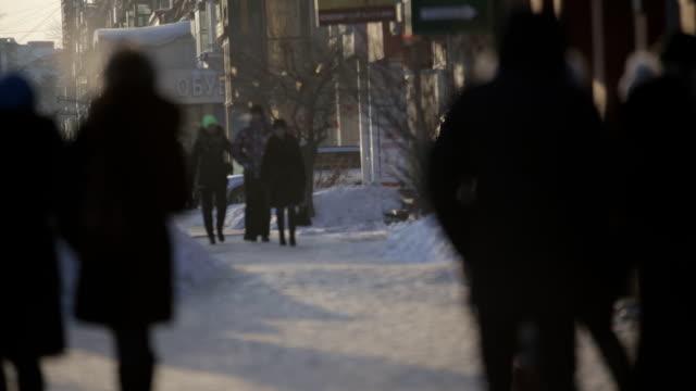 people go on winter snowy street people go on the winter snowy street siberia stock videos & royalty-free footage