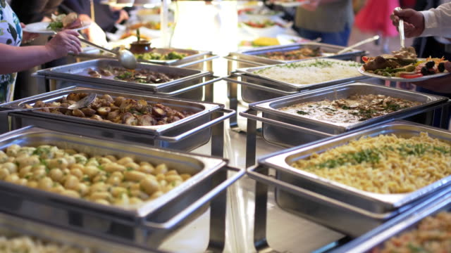people group catering buffet food indoor in luxury restaurant with meat colorful fruits and vegetables. - buffet video stock e b–roll