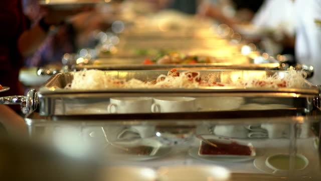 People group catering buffet food indoor in the restaurant. video