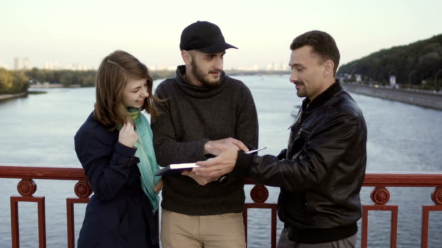 People have the conversation at the bridge video