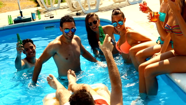People having fun in a swimming pool. video