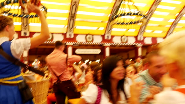 pov t/l people having fun in oktoberfest beer tent - oktoberfest stock videos and b-roll footage