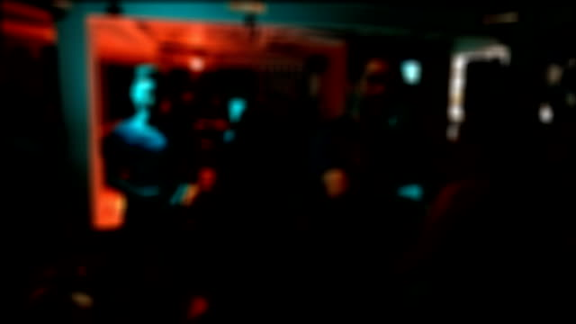 people having joyful dancing in nightclub party, blur shot video