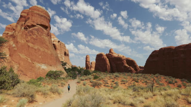 people hiking in arches national park - rock formations stock videos & royalty-free footage