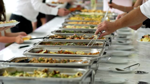 people in all you can eat catering buffet food indoor in luxury restauran. people in all you can eat catering buffet food indoor in luxury restauran. cafeteria stock videos & royalty-free footage