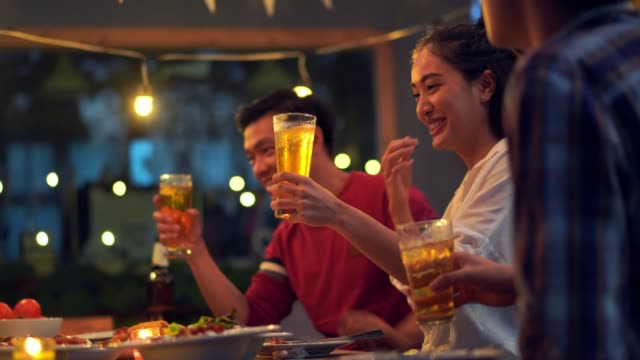 people in asian are celebrating the festival they clink glasses beer and dinner happy - birra video stock e b–roll