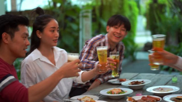 people in asian are celebrating the festival they clink glasses beer and dinner happy - sud est asiatico video stock e b–roll