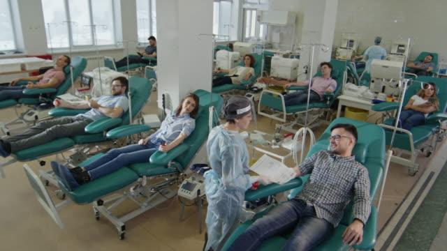 vídeos de stock e filmes b-roll de people in donor center - blood donation
