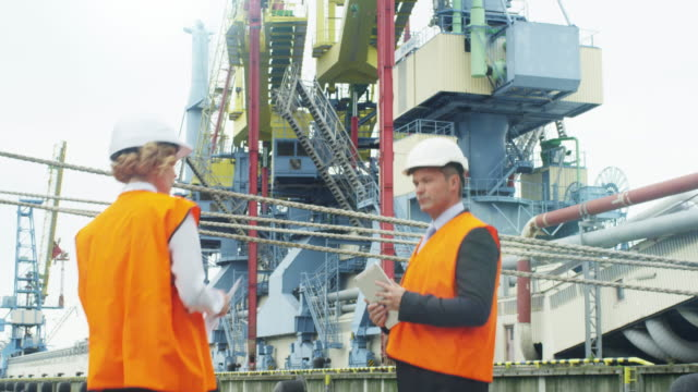 People in Hard Hat are Talking in Industrial Environment