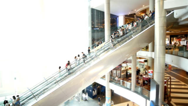 people in motion in escalators at the modern shopping mall. - escalator video stock e b–roll