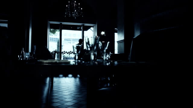 People in Silhouette Cafe video