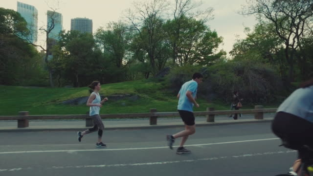 People jogging and cicying in Central Park, New York City People jogging and cicying in Central Park, New York central park manhattan stock videos & royalty-free footage