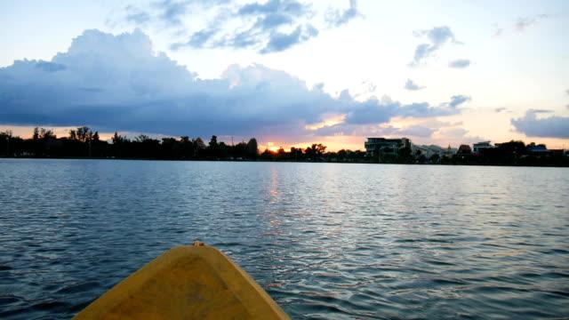 People kayaking on the lake in twilight video