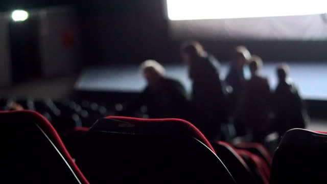 People leave auditorium during the movie performance video