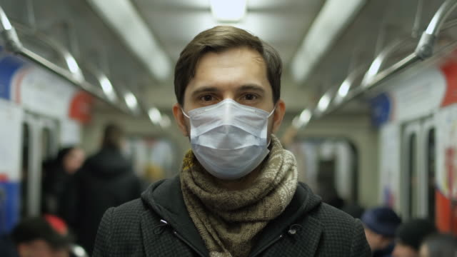 People Look at Camera. Coronavirus. Passenger Train Metro. Subway Corona Virus. video