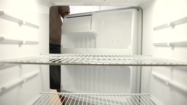 People look for food in empty refrigerator  fridge stock videos & royalty-free footage