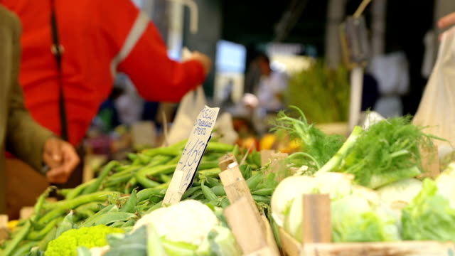 people making shopping at the open-air market: buying vegetables video