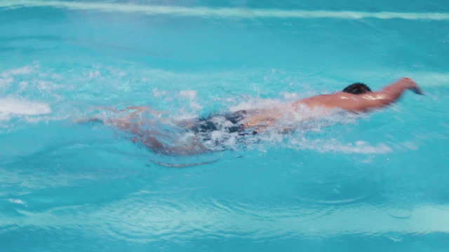 People, man in swimming pool, swimmer training, water sport video