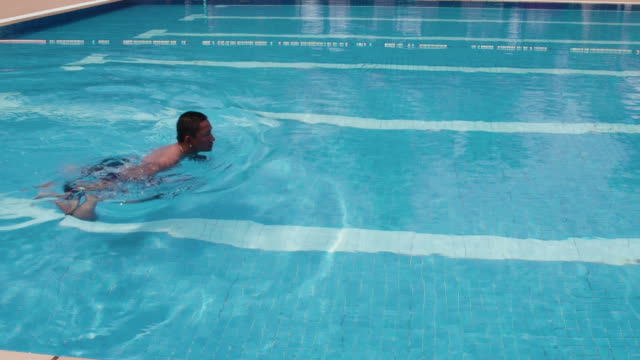 People, man in swimming pool, swimmer training, water sports video