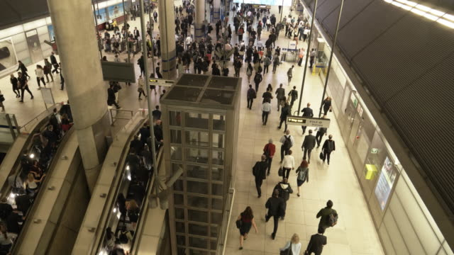 people moving in underground station at rush hour - scala mobile video stock e b–roll