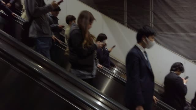 4k people moving on escalator - escalator video stock e b–roll