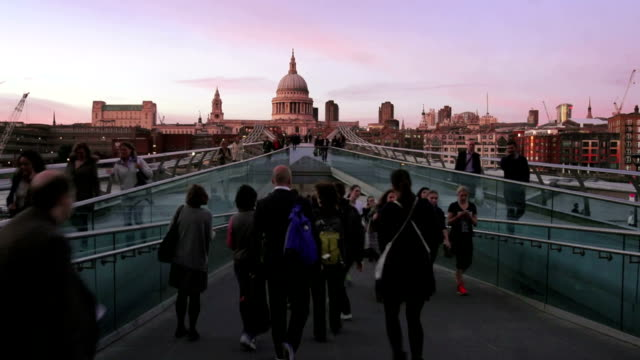 T/L People Moving On London Millennium Bridge At Dusk video