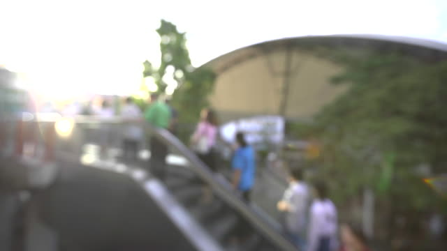 people moving on outdoor escalator video