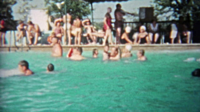 1959: People of all ages playing in public pool during a hot summer day. video