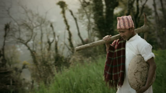 People of Nepal: Happy manual worker with pickaxe and container. video