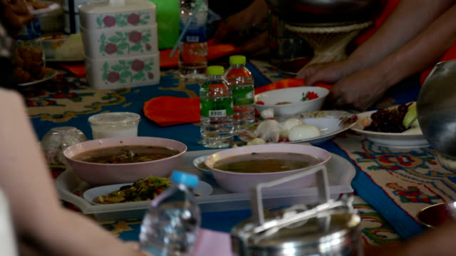 people offerings food for buddhist monk's in temple , Thailand. video