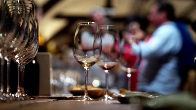 people on a wine tasting in cellar video