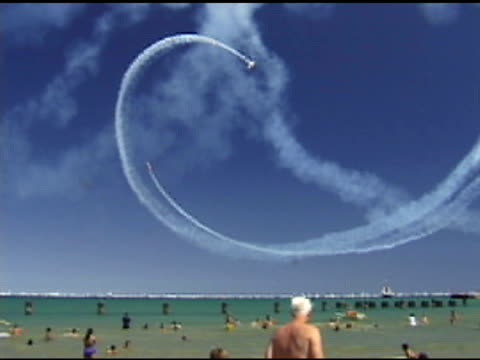 People on beach Watch Air Show video
