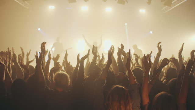 People on concert waving and clapping hands Crowd on conert waving and clapping with their hads, while the band in performing on stage.   rock music stock videos & royalty-free footage