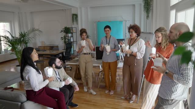 People on lunch break in modern office video