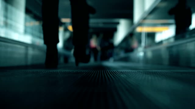 People on moving walkway at airport video