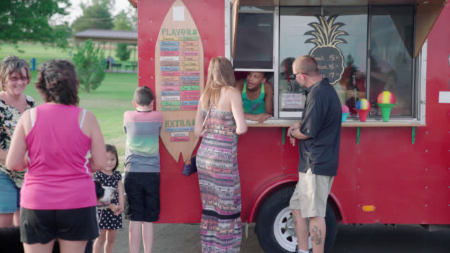 People Ordering From Food Truck From a teenager small business saturday stock videos & royalty-free footage