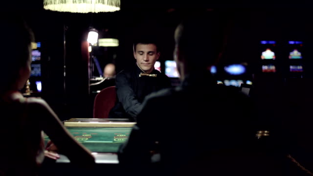 People playing poker in casino video