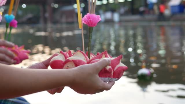 people pray for river god in Loy Krathong festival video