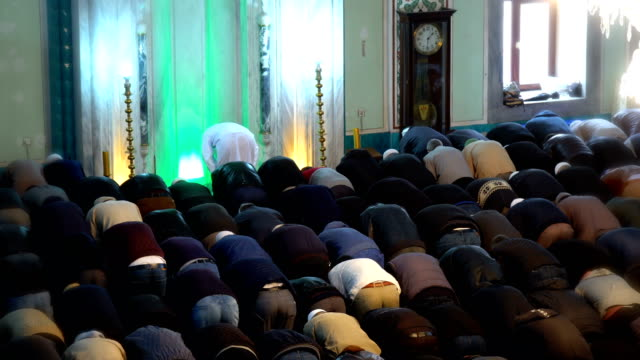 people praying together in mosque - eid mubarak stock videos and b-roll footage