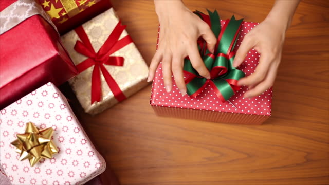People preparing Christmas gifts for children video