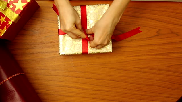 People preparing Christmas gifts video