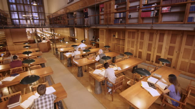 CS People reading and studying in the reading room of a library video