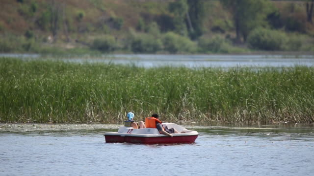 People ride on a catamaran video