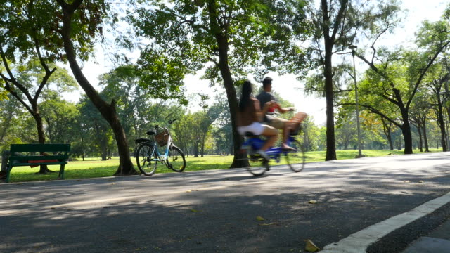 People Riding a Bicycle in Green Park video
