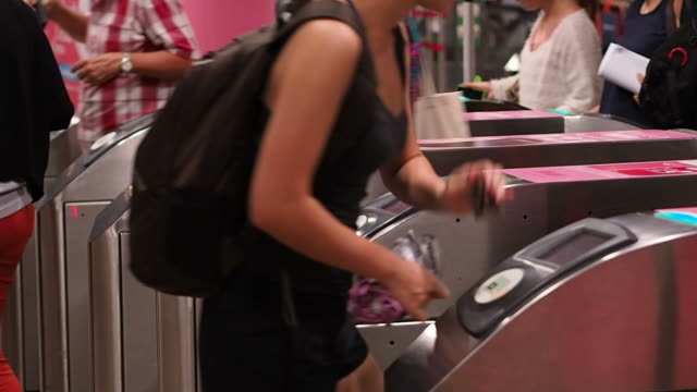 people scanning subway pass at the ticket gate in Singapore video