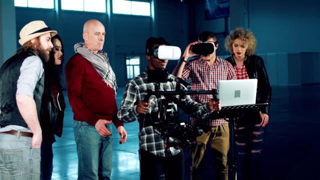 People shooting in vr headset People shooting on special camera wearing vr headset. studio workplace stock videos & royalty-free footage
